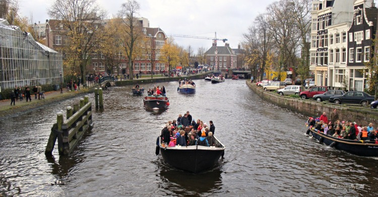 Boats on the canal in Sinterklaas parade; Amsterdam, NL