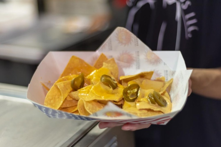 Generous portion of gluten-free and vegan nachos made by Frik-N Vegan Foods LLC