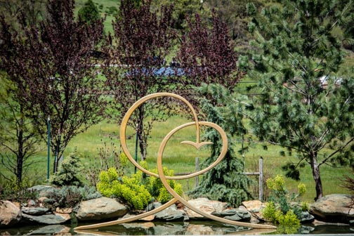 Crystal Hermitage | Ananda Village | Nevada City | Northern California | gardens | tulips | wheelchair accessible | sculpture | Joy is Within You | Spiritual | Symbol