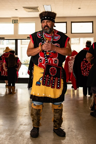 Dance leader, in traditional Southeast Alaskan Native American attire.