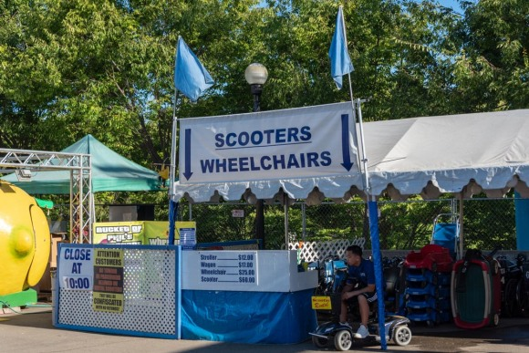 Booth where patrons can rent wheelchairs, scooters, wagons and strollers at the California State Fair.
