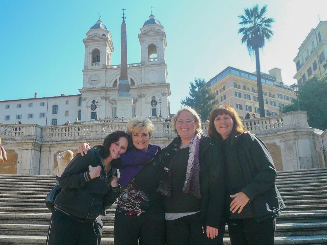 Four women standing on Spanish Steps in Rome, Italy