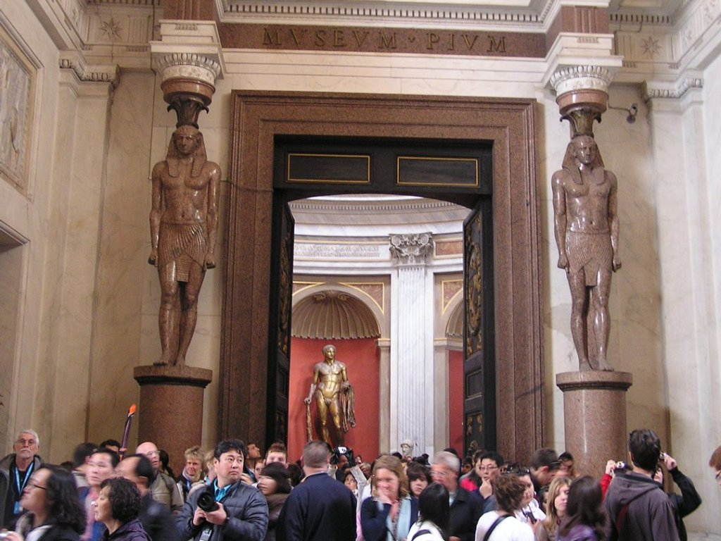 Crowded hallway in Egyptian section of Vatican Museum.